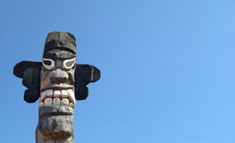 Wooden idol - Jangseung. Wooden idol on the background of blue sky Stock Image