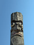 Wooden idol - Jangseung. Wooden idol on the background of blue sky Royalty Free Stock Photo