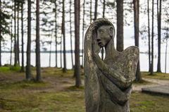 Wooden idol of woman in forest Royalty Free Stock Photo