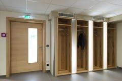 Wooden illuminated garderobe next door Royalty Free Stock Photography