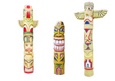 Wooden indian colorful totem pole isolated on white Royalty Free Stock Images