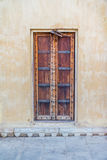 Wooden indian door. A common locked wooden door on a plaster wall Royalty Free Stock Photos