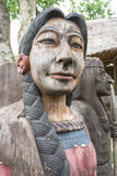 Wooden indian lady. Old wooden indian lady sculpture in the garden Royalty Free Stock Photo