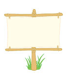 Wooden information board with grass Royalty Free Stock Photography