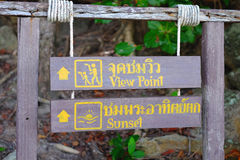 A wooden information plate. Tell about direction of view point and sunset stock images