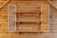 Wooden interior. Detail of wooden interior, wooden shelves on the wall Royalty Free Stock Photo