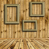 Wooden interior with empty frames Royalty Free Stock Photo