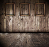 Wooden interior with frames Royalty Free Stock Image