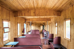 The wooden interior of old russian rail car Stock Photo