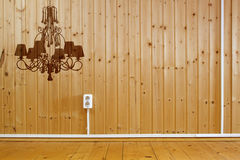 Wooden interior with silhouette of chandelier Royalty Free Stock Images