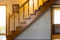 Stairs in the house. Wooden interior staircase to the second floor royalty free stock photos
