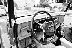 Wooden interior and steering wheel on old vintage retro car. Bla Stock Image