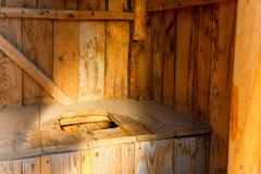 Wooden international toilet day. Old-fashioned simple rustic wooden toilet on International toilet day stock images