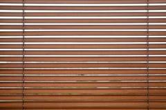 Wooden jalousie. Beautiful wooden jalousie at a window Stock Photos