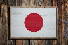 Wooden Japan flag. 3d rendering of Japan flag on a wooden frame over a planks wall Stock Photo