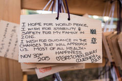 Wooden Japanese prayer tablets with wishes Stock Photos
