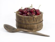 Wooden jar full of red cherries Stock Images