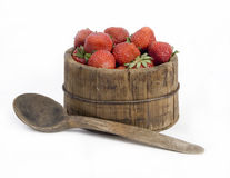 Wooden jar full of red strawberries Stock Images