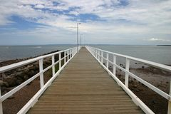 Wooden Jetty. Looking out into the distance on a waterfront jetty Stock Image
