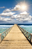 Wooden jetty. On a crystalline sea Royalty Free Stock Photos