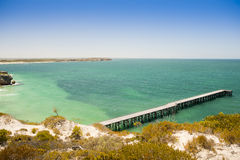 Wooden Jetty. Long wooden jetty stretches out into clear water at Stenhouse Bay, South Australia Royalty Free Stock Images