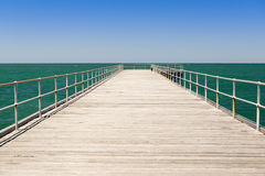 Wooden Jetty. Long wooden jetty stretches out into clear water at Stenhouse Bay, South Australia Royalty Free Stock Photography