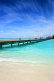 Wooden jetty. On over the beautiful Maldivian beach Stock Photos