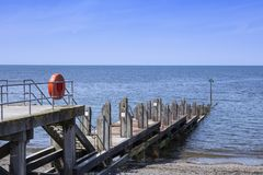 Wooden jetty in Aberystwyth Ceredigion Mid Wales UK. Lifebuoy on wooden jetty in Aberystwyth Wales UK Stock Photography