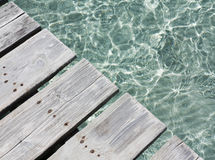 Wooden jetty at the beach. Royalty Free Stock Photo