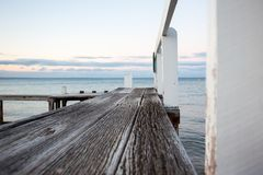 Wooden Jetty at the beach royalty free stock photography