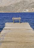 Wooden jetty and bench Stock Image