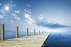 Wooden jetty blue ocean Royalty Free Stock Photo