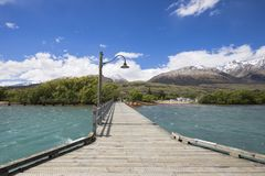Wooden jetty on Lake Wakatipu, Glenorchy, New Zealand. Wooden jetty with blue sky on Lake Wakatipu in Glenorchy, New Zealand Stock Photos