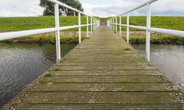 Wooden jetty and a concrete staircase on an embankment Royalty Free Stock Photo