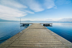 Wooden jetty with daylight at Viverone Lake, Italy Royalty Free Stock Photos