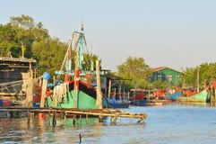 Wooden jetty and deep sea fishing boat dock at the bay at fishin. G village Royalty Free Stock Photos