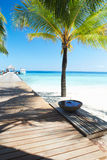 Wooden Jetty On Deserted Tropical Palm Beach In Maldives Royalty Free Stock Photography