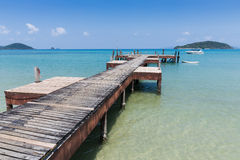 Wooden jetty on exotic beach Koh Chang island, Royalty Free Stock Images