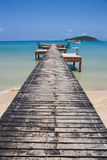 Wooden jetty on exotic beach Koh Chang island Stock Photos