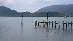 Wooden jetty on exotic beach Koh Chang island, Thailand Stock Photo