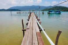 Wooden jetty on exotic beach Koh Chang island, Thailand Stock Image