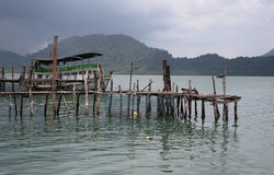 Wooden jetty on exotic beach Koh Chang island, Thailand Royalty Free Stock Images