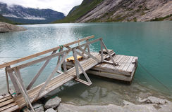 Wooden jetty in the fjord in Norway Royalty Free Stock Images