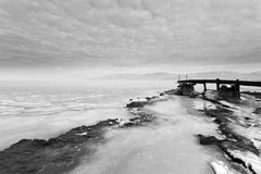 Wooden jetty. In the frozen lake Stock Photo