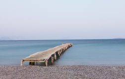 Wooden jetty at Ipsos beach. Corfu island, Greece Royalty Free Stock Photography