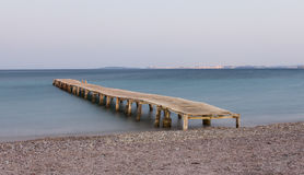 Wooden jetty at Ipsos beach. Corfu island, Greece Royalty Free Stock Image