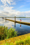 Wooden jetty in a lake diagonally in the picture Royalty Free Stock Photo
