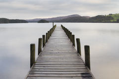 Wooden jetty  in the lake district Stock Photos