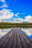 Wooden jetty on a lake Royalty Free Stock Photos