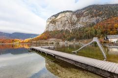 Wooden Jetty in lake at Obertraun city opposite the Hallstatt Au Stock Photo